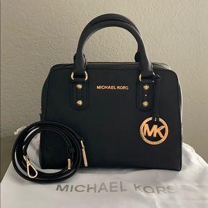 Michael Kors black saffiano leather satchel.